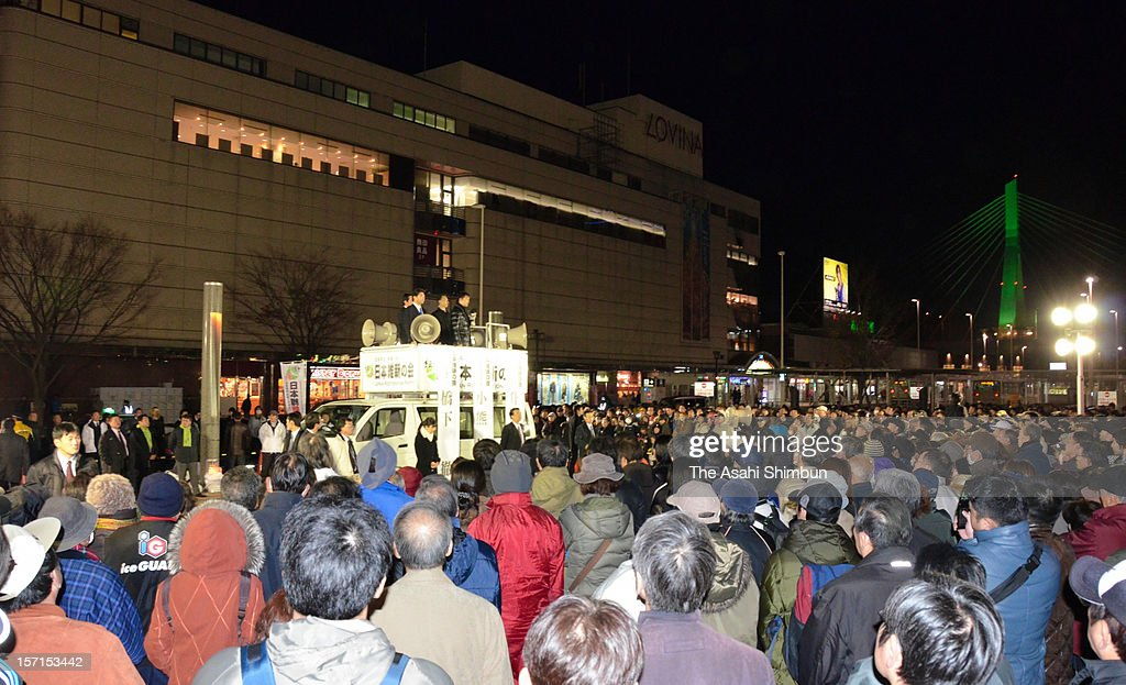 People gather to listen to the speech by the Japan Restoration Party Acting President Toru Hashimoto in front of the Aomori Station on November 28, 2012 in Aomori, Japan. Japanese people vote in the general election on December 16.