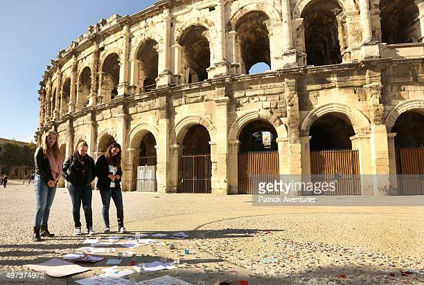 People gather to observe a minute's silence at the Nimes Roman arena in memory of the victims of the Paris terror attacks last Friday on November 16...