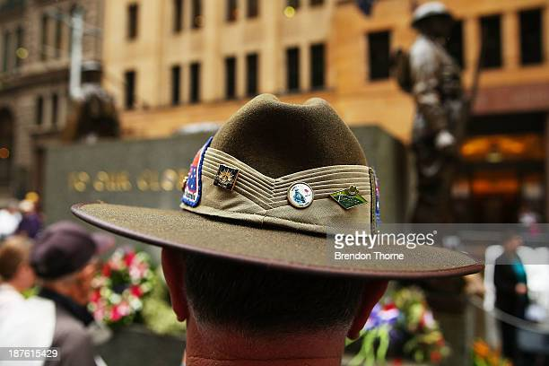 People gather to pay tribute at the Cenotaph during the Rememberance Day Service held at the Cenotaph Martin Place on November 11 2013 in Sydney...