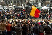 People gather to pay tribute to the victims of the Brussels attacks on the Place de la Bourse in central Brussels on March 24 two days after a triple...