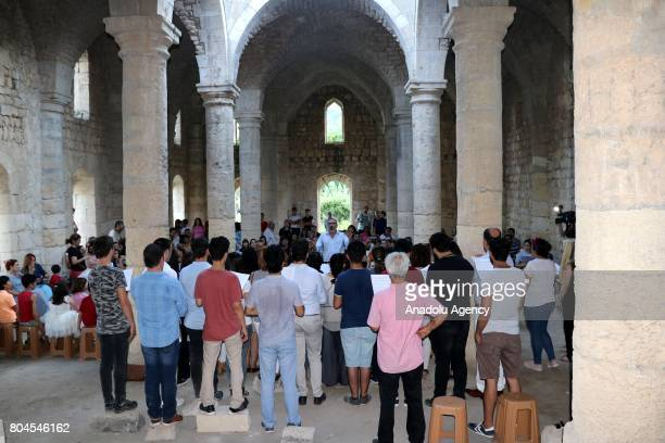 People gather to perform 'Peace Ritual' during the Feast of Saints Peter and Paul at Batiayaz Armenian Church in Antakya Turkey on June 30 2017 An...