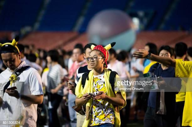 People gather to play Nintendo Co's Pokemon Go augmented reality game during the Pokemon Go Stadium event at Yokohama Stadium that was held as part...