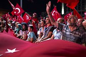 People gather to protest against Parallel State/Gulenist Terrorist Organization's failed military coup attempt at Taksim Square in Istanbul Turkey on...