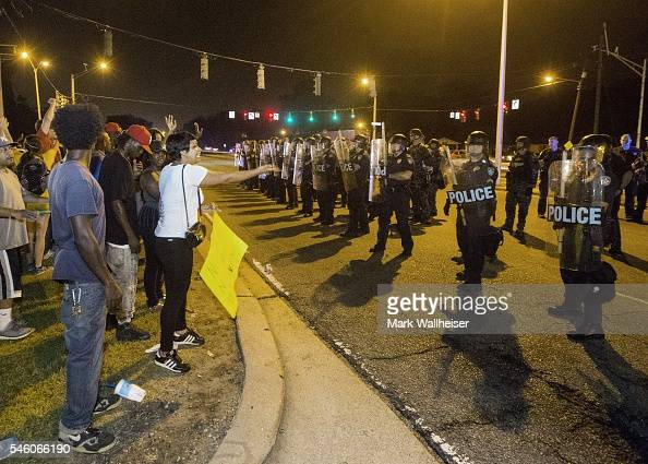 People gather to protest against the shooting of Alton Sterling on July 10 2016 in Baton Rouge Louisiana Alton Sterling was shot by a police officer...