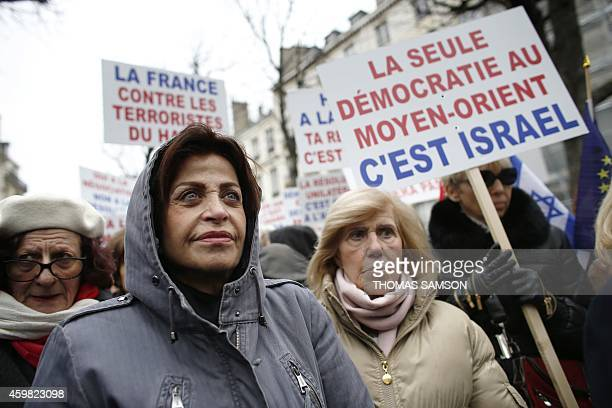 People gather to protest against the vote by French lawmakers of a symbolic nonbinding motion to recognise Palestine on December 2 2014 in front of...