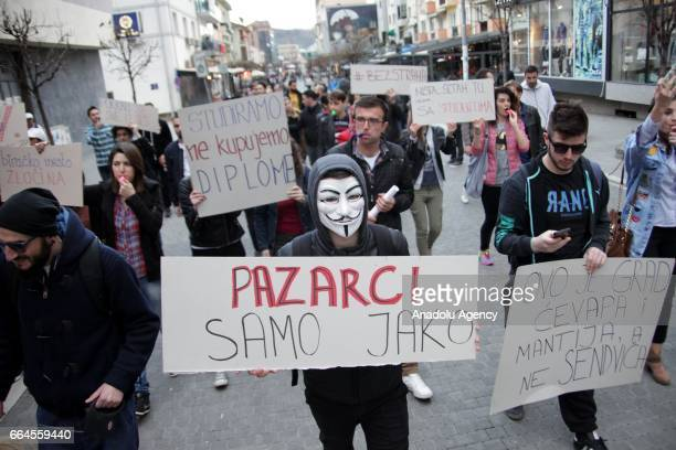 People gather to protest election victory of Serbian President Aleksandar Vucic leader of Serbian Progressive Party in Novi Pazar Serbia on April 04...