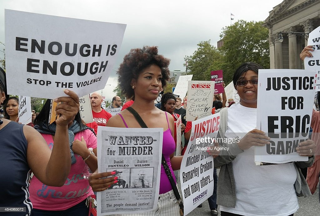 People gather to protest the killing of Eric Garner in New York, United States, on August 24, 2014. Garner, 43, died on July 17 as cops tried to cuff him for allegedly selling bootleg cigarettes on a Staten Island sidewalk.