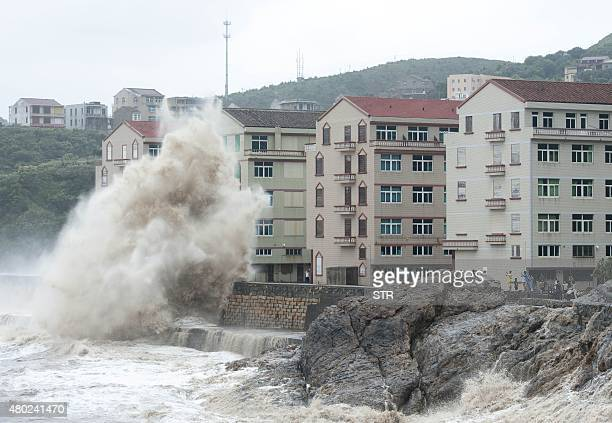People gather to see huge waves as typhoon Chanhom comes near Wenling east China's Zhejiang province on July 10 2015 Typhoon Chanhom lashed Japan's...