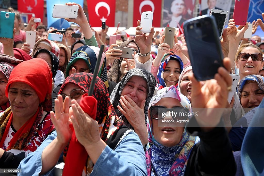 People gather to see Turkish President Recep Tayyip Erdogan as he attends the opening ceremony of Fethiye Hasan Gumusdag Mosque in Istanbul, Turkey on July 1, 2016.