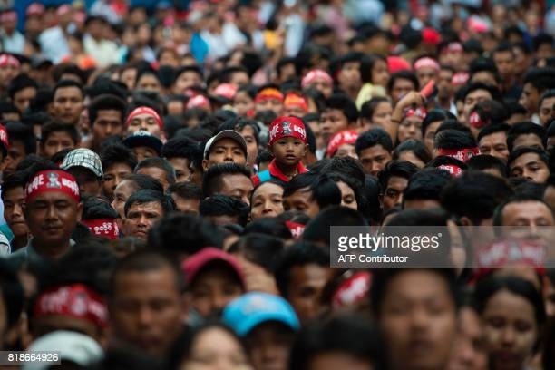 TOPSHOT People gather to visit the Martyrs' Mausoleum to attend a ceremony marking Myanmar's 70th Martyrs' Day anniversary in Yangon on July 19 2017...