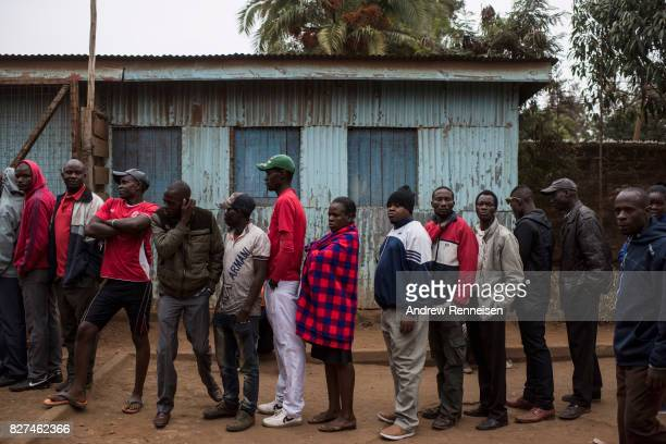 People gather to vote at Olympic Primary School in Kibera one of the largest slums in Africa on August 8 2017 in Nairobi Kenya Kenyans head to the...