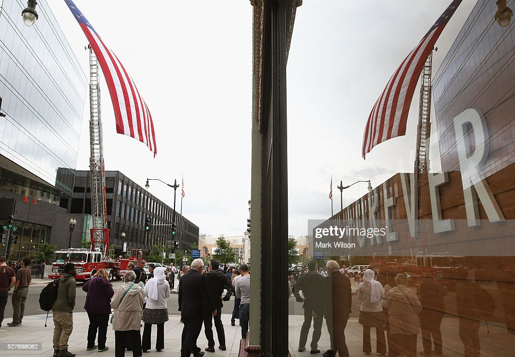 People gather to watch a law enforcement parade at the start of the 22nd annual 'Blue Mass' at St. Patrick's Catholic Church May 3, 2016 in Washington, DC. The mass is held by the National Law Enforcement Officers Memorial Fund to recognize the first responders who have given their lives in the past year.