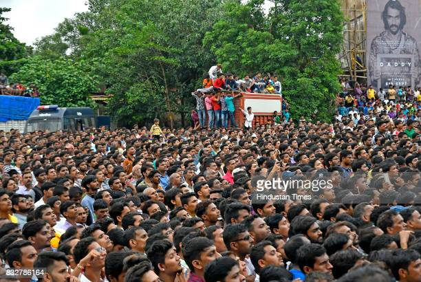 People gather to watch Dahi Handi celebration at Ghatkopar on August 15 2017 in Mumbai India The childgod Krishna and his friends used to form human...