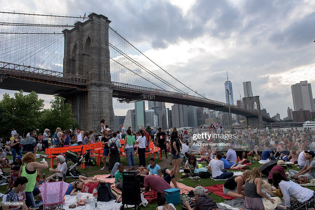 People gather to watch the Macy's Fourth of July Fireworks from Brooklyn Bridge Park in Brooklyn New York on July 4 2015