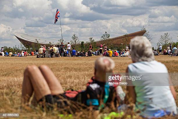 People gather to watch the Tour de France cyclists pass through the Olympic Park in Stratford