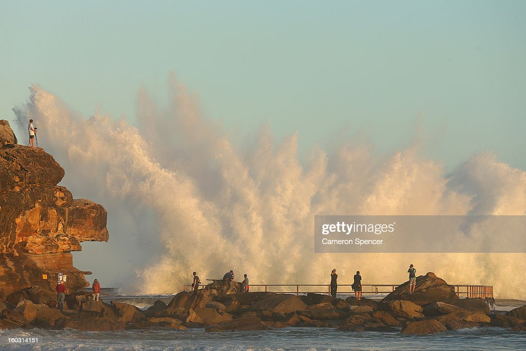 People gather to watch waves crash over North Curl Curl ocean pool after winds and rain battered Sydney last night producing large swell on January 29, 2013 in Sydney, Australia. Parts of Sydney are experienced record rainfall after ex-cyclone Oswald swept through the city last night.