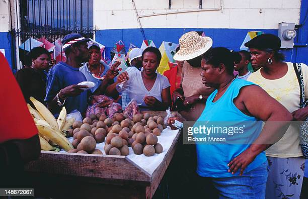 People gathered around a fruit stall at Public Market.