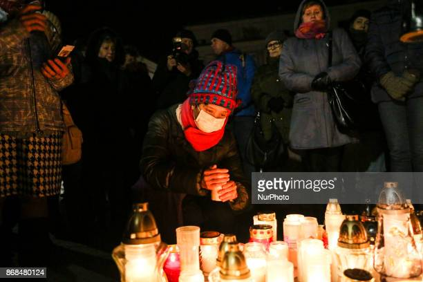 People gathered at the Main Square in Krakow to light candles for a man who set himself alight in an act of self immolation ten days before in Warsaw...