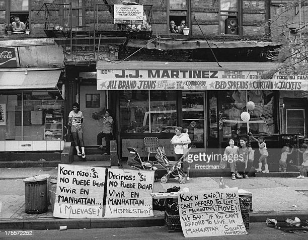 People gathered outside a clothes store in Spanish Harlem on the Upper East Side New York City 1980