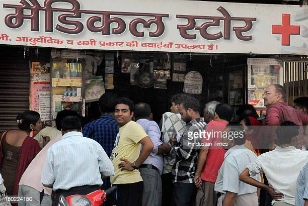 People gathered outside medical store as curfew was lifted temporarily for two hours on September 10 2013 in Muzaffarnagar India No untoward incident...