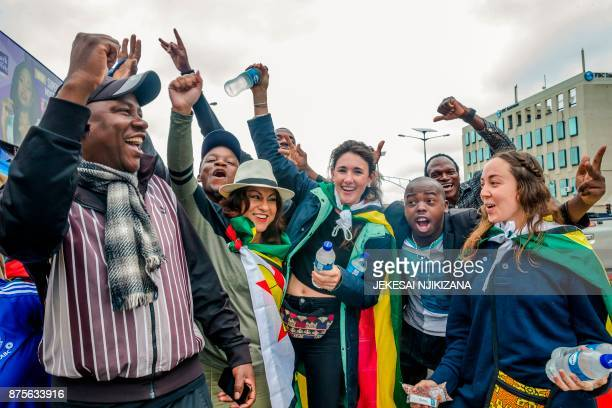 People gesture and shout slogans during a demonstration demanding the resignation of Zimbabwe's president on November 18 2017 in Harare Zimbabwe was...