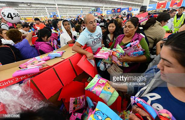 People get an early start on Black Friday shopping deals at a Walmart Superstore on November 22 2012 in Rosemead California as many retailers stayed...