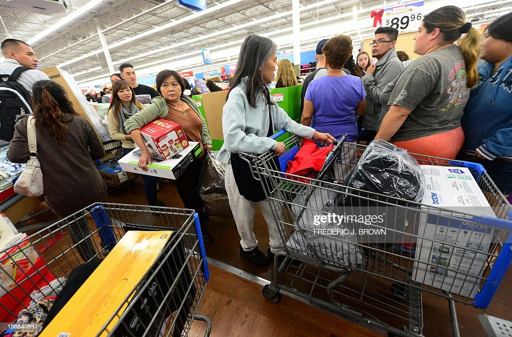 People get an early start on Black Friday shopping deals at a Walmart Superstore on November 22, 2012 in Rosemead, California, as many retailers stayed opened during the Thanksgiving celebrations, evidence that even this cherished American family holiday is falling prey to the forces of commerce. AFP PHOTO / Frederic J. BROWN