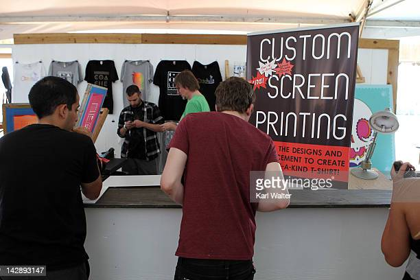 People get custom screen printing tshirts during day 2 of the 2012 Coachella Valley Music Arts Festival at the Empire Polo Field on April 14 2012 in...