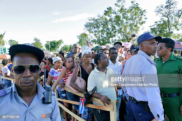 People get in line to visit the grave that holds the ashes of Cubas Revolution leader Fidel Castro at the Santa Ifigenia cemetary on December 4 in...