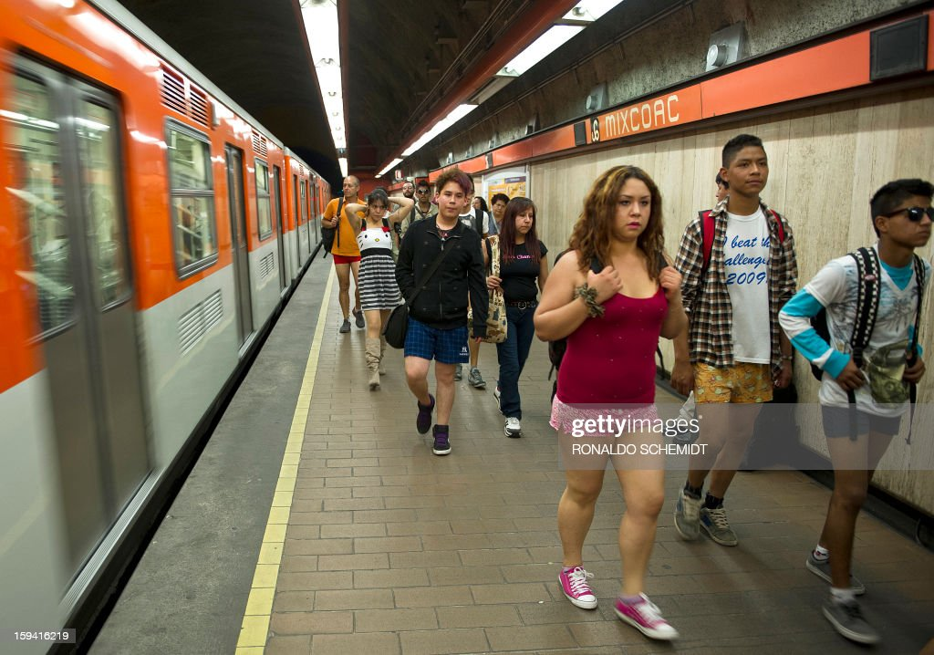 People get off a train at a subway station during the worldwide 'No Pants Subway Ride' event in Mexico City on January 13, 2013. The 'No Pants Subway Ride', though in its 12th year, still surprises fellow passengers on public transit, and is spreading to other cities across the globe.