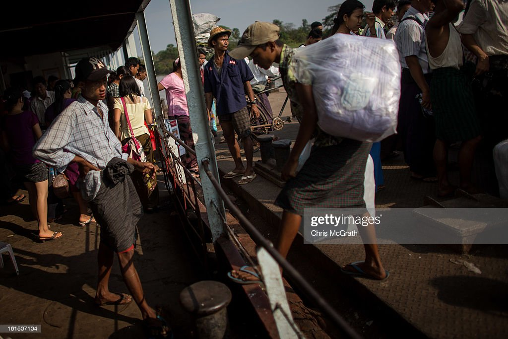 People get off the ferry at Dala jetty on February 11, 2013 in Yangon, Burma. Myanmar is going through rapid political and economic reforms initiated by the countries first civilian president Thein Sein after years of military junta rule.