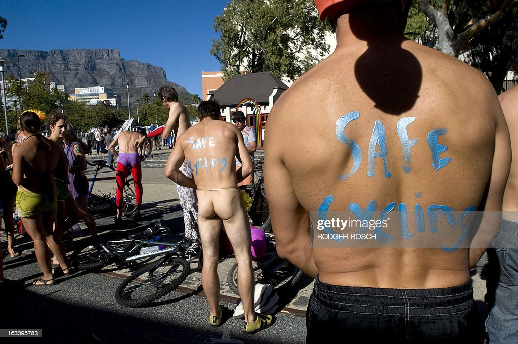 People get ready to take part in the 3rd annual Cape Town Naked Bike Ride on March 9, 2013 in Cape Town. This event is a protest against car culture and to raise awareness of cycling as an environmentally friendly option. The World Naked Bike Ride(WNBR) is an initative that takes place in over 50 cities around the world.