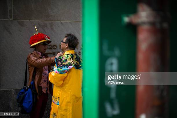 People get the last touch during the Annual Easter parade on April 16 2017 in New York City The Easter Parade and Easter Bonnet Festival is...