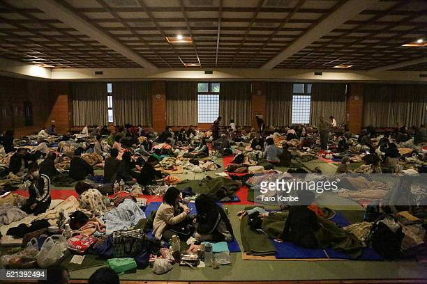 People get up right after the 73 magnitude earthquak at the evacuation center at the Mashiki Town Gymnasium on April 16 2016 in Mashiki Kumamoto...