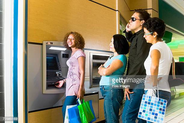 People getting impatient in long line at the ATM