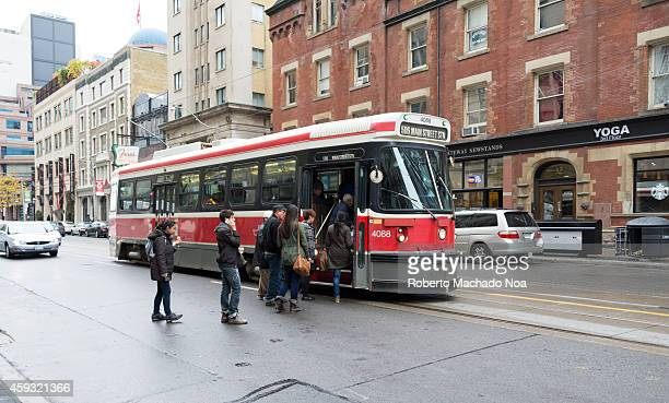 DOWNTOWN TORONTO ONTARIO CANADA People getting on a Toronto streetcar this old Bombardier streetcars will be replaced in a lapse of five years by the...
