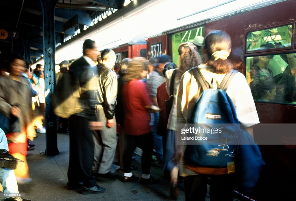 People getting onto subway train, New York City, USA (blurred motion)
