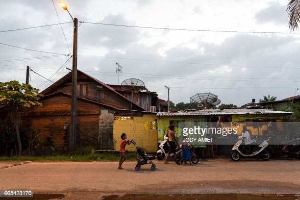 People go about with their daily life on March 31 2017 in the district MatineLeblond of Cayenne French Guiana Air France canceled its scheduled...