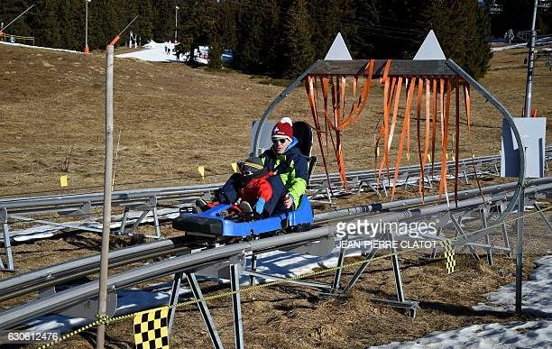 People go sledging on December 28 2016 at the Saisies ski resort Three weeks after the start of t he ski season '30 to 40% of the seasonal workers'...