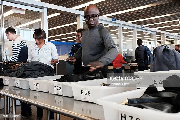 People go through security at JFK Airport the day before Thanksgiving on November 25 2015 in the Queens borough of New York City One of the biggest...