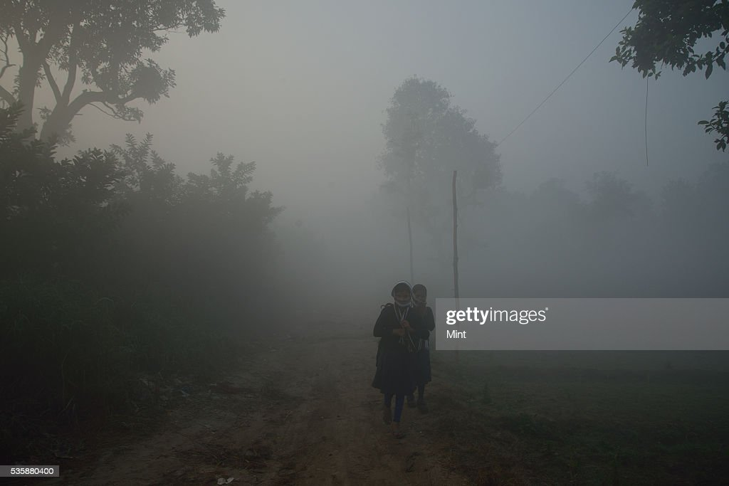 People going for work in early winter morning at bank of Yamuna on December 9, 2015 in New Delhi, India.