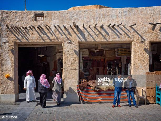 People going in and out Souq Waqif, Doha, Qatar - February 4, 2017