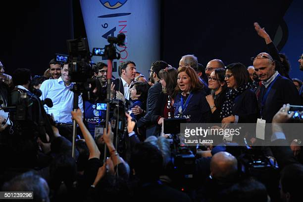 People greet Italian Prime Minister Matteo Renzi after his speech during the meeting of the Leopolda 2015 on December 13 2015 in Florence Italy The...