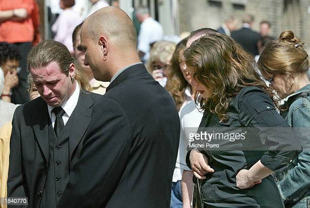 People grieve after paying their respects to slain politician Pim Fortuyn may 9 2002 at a cathedral in Rotterdam Netherlands Thousands of people...