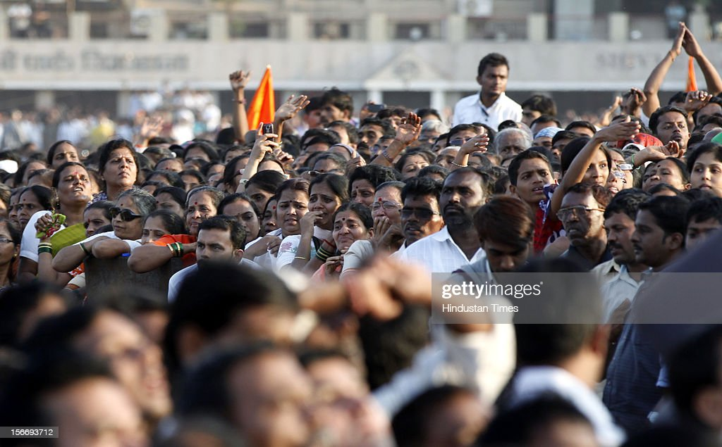 People grieve during Bal Thackeray' funeral at Shivaji Park on November 18, 2012 in Mumbai, India. Bal Thackeray passed away on November 17, 2012 at the age of 86 years.