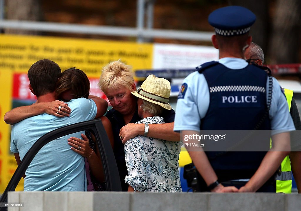 People grieve outside the Muriwai Surf Lifesaving Club after a swimmer died in a fatal shark attack at Muriwai Beach on February 27, 2013 in Auckland, New Zealand. The victim was a local Muriwai man who was swimming several hundred metres from the shore at the time of the attack.