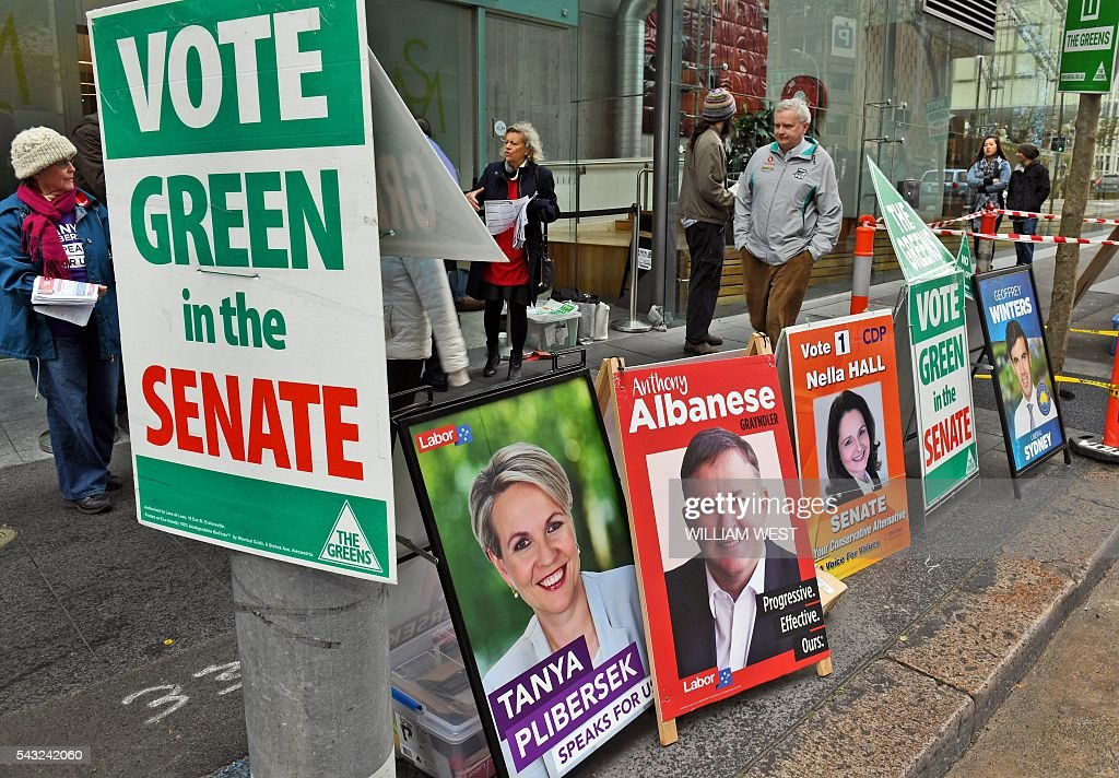 People hand out how-to-vote pamphlets outside a polling station in Sydney's central business district on June 27, 2016, which is open to voters who will be absent on election day. Australia's ruling party on June 27 used the Brexit vote to warn against voting for Labor in upcoming elections as a poll showed the Liberals ahead for the first time in a drawn-out campaign. WEST