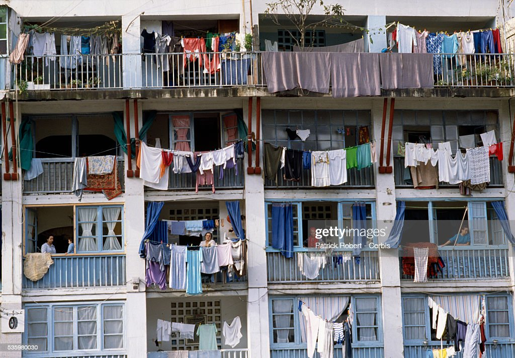 People hang their laundry outside the balconies of their apartments in Algiers.