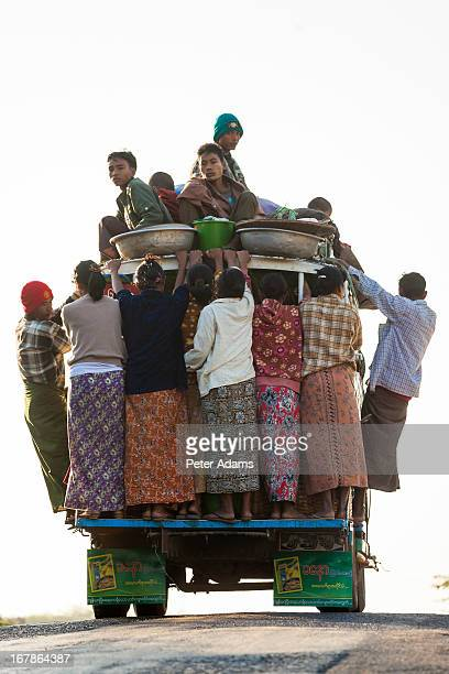 People Hanging off a Minibus, Bagan, Myanmar
