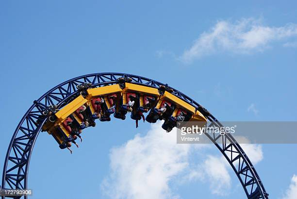 People hanging upside down on the roller coaster track